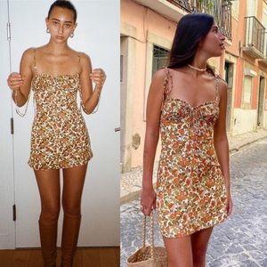 $180 Réalisation Par The Devon Mini Dress